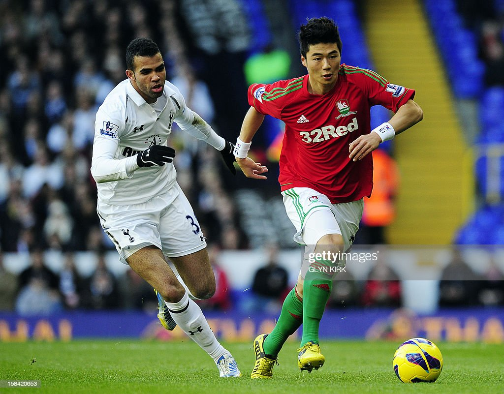 """Swansea City's South Korean midfielder Ki Sung-Yueng (R) vies with Tottenham Hotspur's Brazilian midfielder Sandro (L) during the English Premier League football match between Tottenham Hotspur and Swansea City at White Hart Lane in north London on December 16, 2012. USE. No use with unauthorized audio, video, data, fixture lists, club/league logos or """"live"""" services. Online in-match use limited to 45 images, no video emulation. No use in betting, games or single club/league/player publications"""