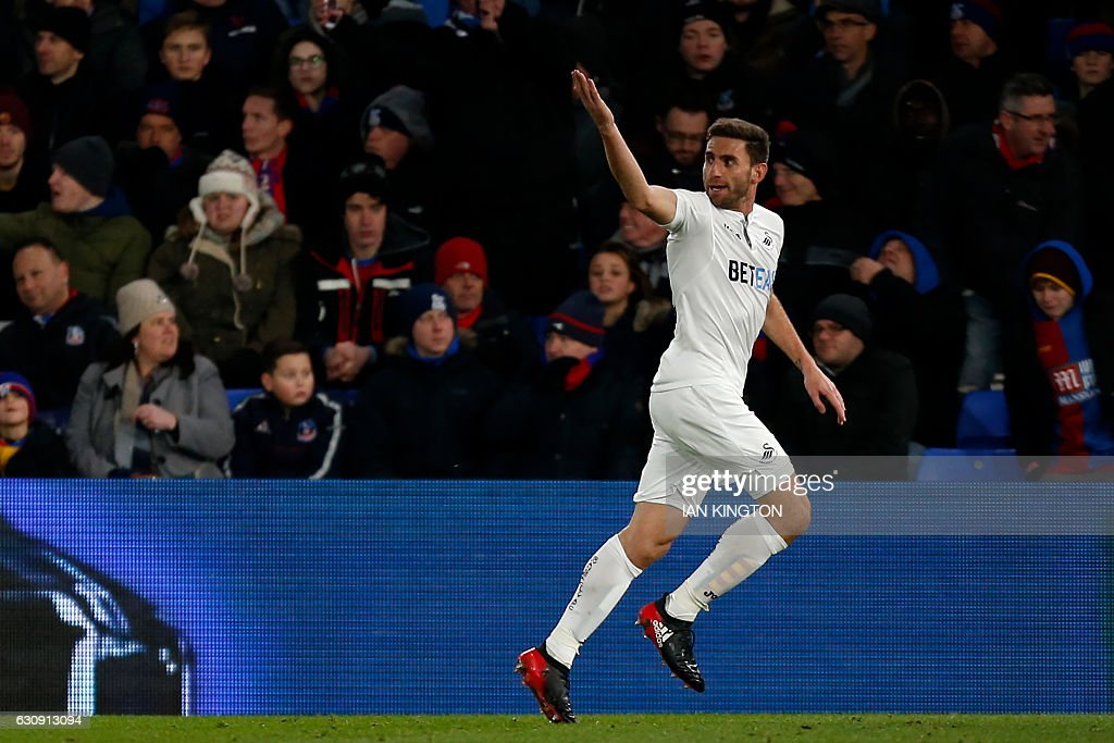 Swansea City's Spanish defender Angel Rangel celebrates after scoring their second goal during the English Premier League football match between Crystal Palace and Swansea City at Selhurst Park in south London on January 3, 2017. Swansea won the game 2-1. / AFP / Ian KINGTON / RESTRICTED TO EDITORIAL USE. No use with unauthorized audio, video, data, fixture lists, club/league logos or 'live' services. Online in-match use limited to 75 images, no video emulation. No use in betting, games or single club/league/player publications. /