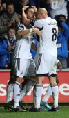 Swansea City's Spanish defender Chico Flores is congratulated by team mate British midfielder Jonjo Shelvey after he scored a goal during a Premier...