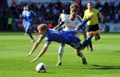 Swansea City's Spanish defender Chico Flores tackles Chelsea's German striker Andre Schurrle in a challenge which led to Flores being sent off during...