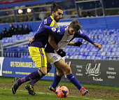 Swansea City's Spanish defender Chico Flores vies with Birmingham City's Danish striker Peter Lovenkrands during the English FA Cup fourth round...