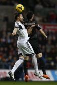 Swansea City's Spanish defender Chico Flores wins a header against Manchester City's Spanish striker Alvaro Negredo during the English Premier League...