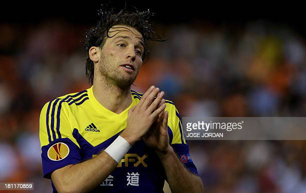 Swansea City's Spanish midfielder Miguel Michu celebrates after scoring during the UEFA Europa league football match Valencia CF vs Swansea City AFC...