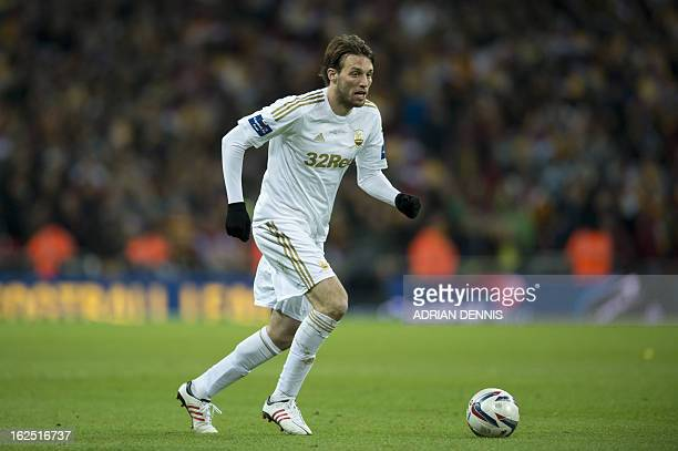 Swansea City's Spanish midfielder Miguel Michu controls the ball during the League Cup final football match between Bradford City and Swansea City at...