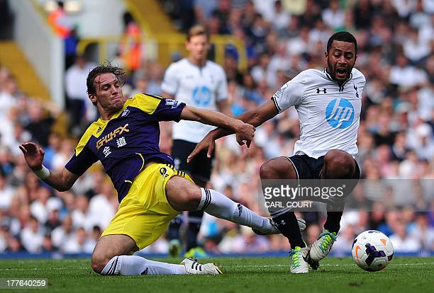 Swansea City's Spanish midfielder Miguel Michu vies with Tottenham Hotspur's Belgium midfielder Moussa Dembele during the English Premier League...