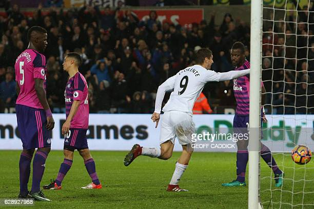 Swansea City's Spanish striker Fernando Llorente celebrates after scoring their third goal during the English Premier League football match between...