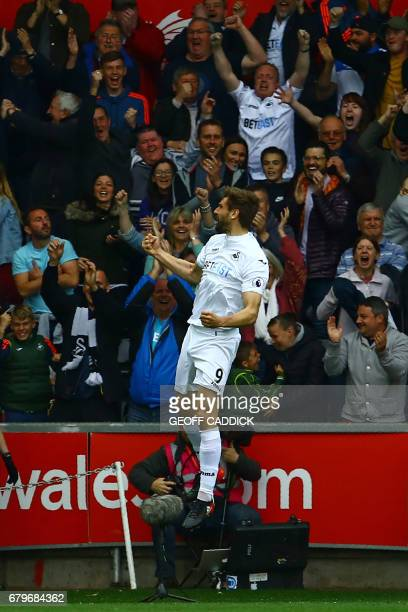 Swansea City's Spanish striker Fernando Llorente celebrates after scoring the opening goal of the English Premier League football match between...