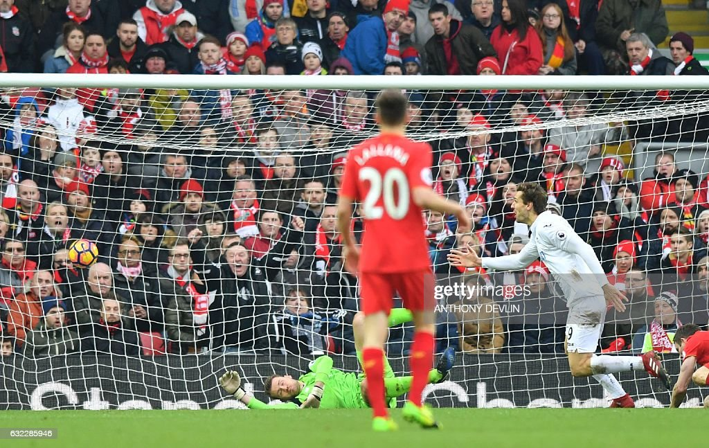 Swansea City's Spanish striker Fernando Llorente (R) celebrates scoring their second goal during the English Premier League football match between Liverpool and Swansea City at Anfield in Liverpool, north west England on January 21, 2017. / AFP / Anthony DEVLIN / RESTRICTED TO EDITORIAL USE. No use with unauthorized audio, video, data, fixture lists, club/league logos or 'live' services. Online in-match use limited to 75 images, no video emulation. No use in betting, games or single club/league/player publications. /