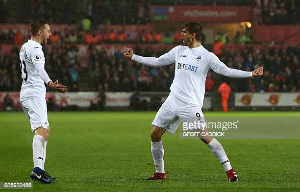 Swansea City's Spanish striker Fernando Llorente celebrates with Swansea City's Icelandic midfielder Gylfi Sigurdsson after scoring their second goal...