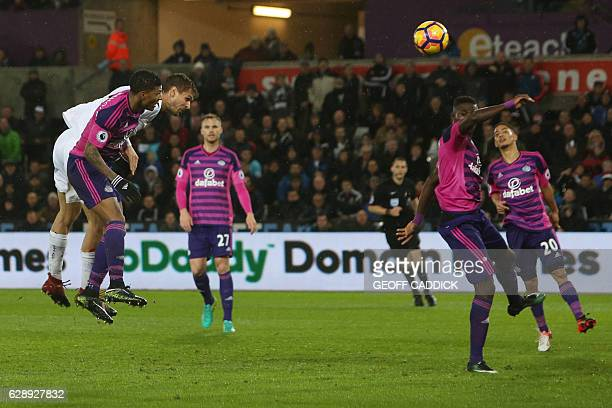 Swansea City's Spanish striker Fernando Llorente heads the ball to score their third goal during the English Premier League football match between...
