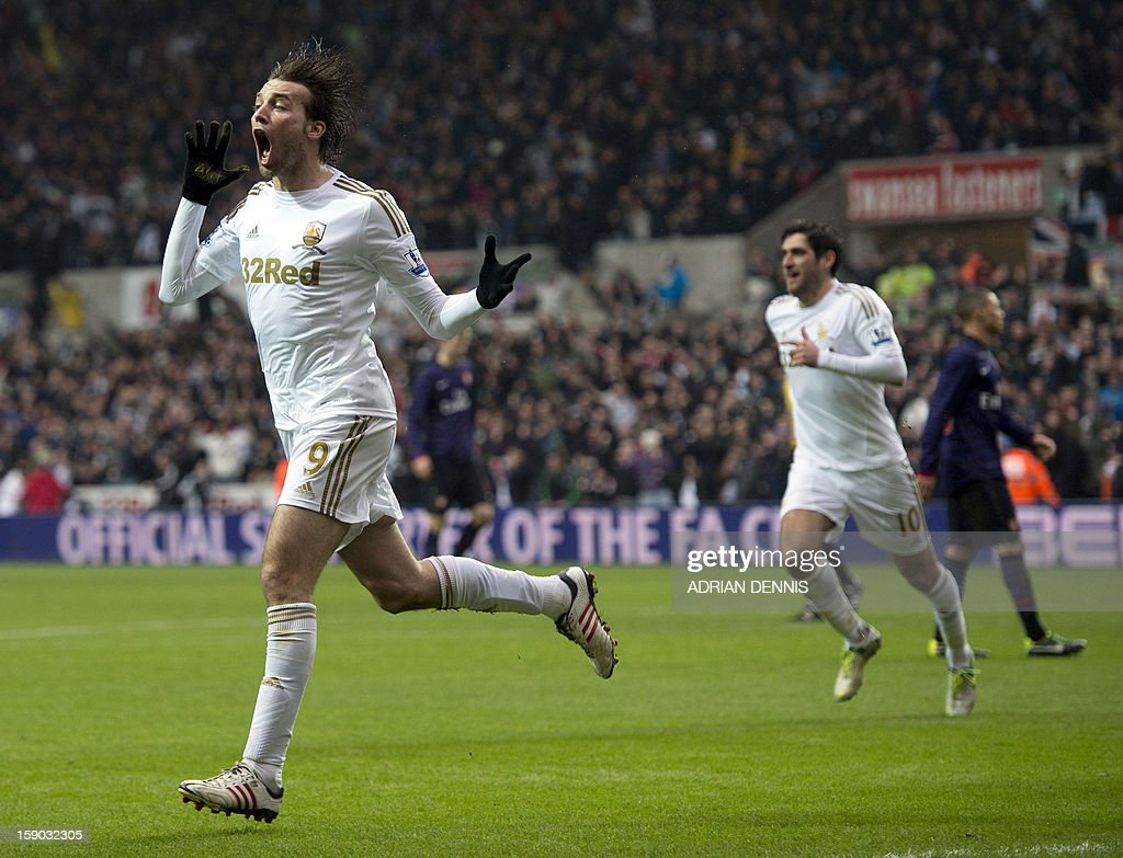 "Swansea City's Spanish striker Miguel Michu (L) runs to celebrate after scoring the opening goal against Arsenal during the FA Cup third round football match at the Liberty Stadium in Swansea, Wales, on January 6, 2013. The game ended with a 2-2 draw. RESTRICTED TO EDITORIAL USE. No use with unauthorized audio, video, data, fixture lists, club/league logos or ""live"" services. Online in-match use limited to 45 images, no video emulation. No use in betting, games or single club/league/player publications"