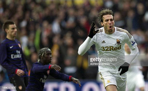 Swansea City's Spanish striker Miguel Michu runs to celebrate after scoring the opening goal against Arsenal during the FA Cup third round football...