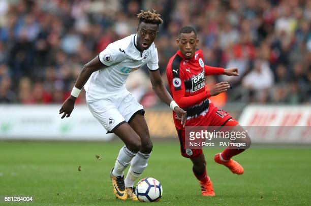 Swansea City's Tammy Abraham amd Huddersfield Town's Rajiv van La Parra battle for the ball during the Premier League match at the Liberty Stadium...