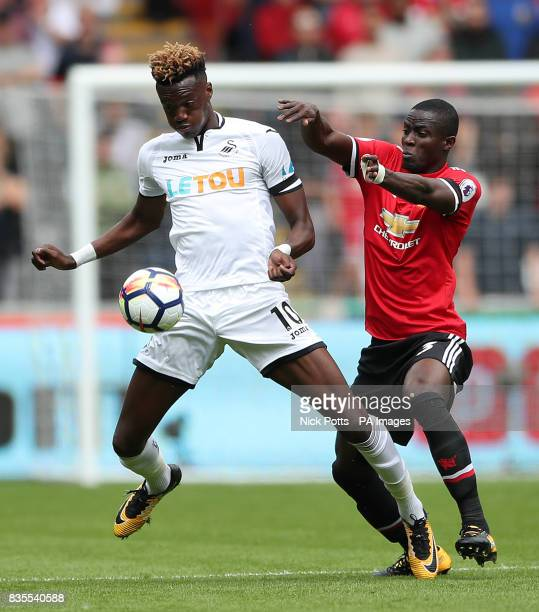 Swansea City's Tammy Abraham and Manchester United's Eric Bailly in action during the Premier League match at the Liberty Stadium Swansea