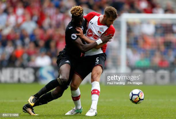 Swansea City's Tammy Abraham and Southampton's Jack Stephens battle for the ball during the Premier League match at St Mary's Stadium Southampton