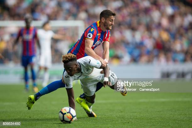 Swansea City's Tammy Abraham is fouled by Crystal Palace's Joel Ward during the Premier League match between Crystal Palace and Swansea City at...
