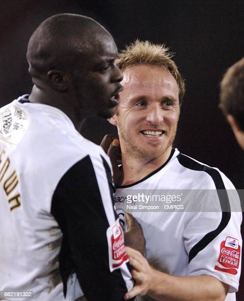 Swansea City's Thomas Butler and Adebayo Akinfenwa celebrate at the end of the match