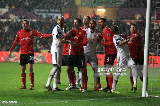 Swansea City's Wayne Routledge and Cardiff City's Gary Medel square up before a corner