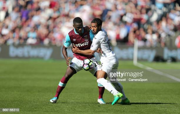 Swansea City's Wayne Routledge and West Ham United's Arthur Masuaku during the Premier League match between West Ham United and Swansea City at...