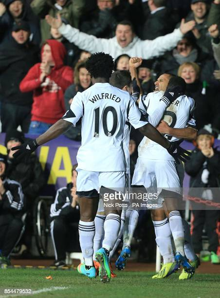 Swansea City's Wayne Routledge celebrates with teammates scoring his team's opening goal