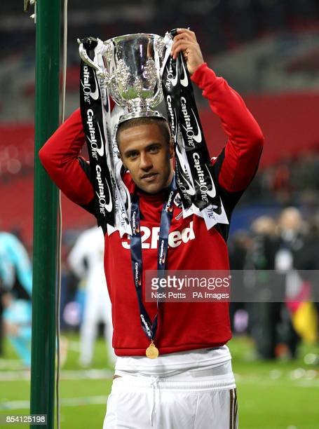 Swansea City's Wayne Routledge celebrates with the trophy after the game
