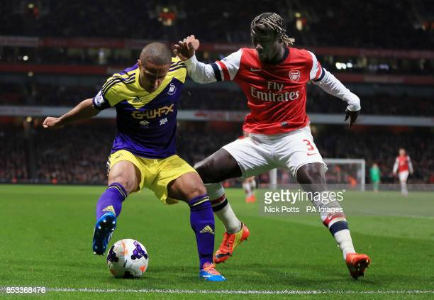 Swansea City's Wayne Routledge defends the ball away from Arsenal's Bacary Sagna during the Barclays Premier League match at the Emirates Stadium...
