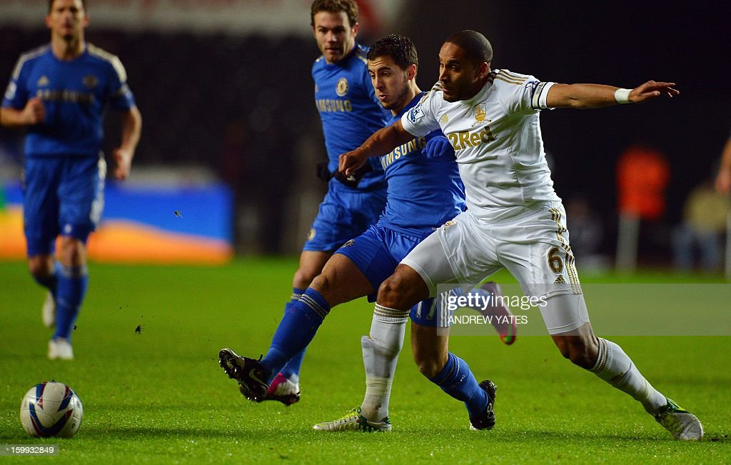 """Swansea City's Welsh defender Ashley Williams (R) vies with Chelsea's Belgium midfielder Eden Hazard (L) during the English League Cup semi-final second leg football match between Swansea City and Chelsea at The Liberty stadium in Cardiff, south Wales on January 23, 2013. AFP PHOTO/ANDREW YATES USE. No use with unauthorized audio, video, data, fixture lists, club/league logos or """"live"""" services. Online in-match use limited to 45 images, no video emulation. No use in betting, games or single club/league/player publications."""