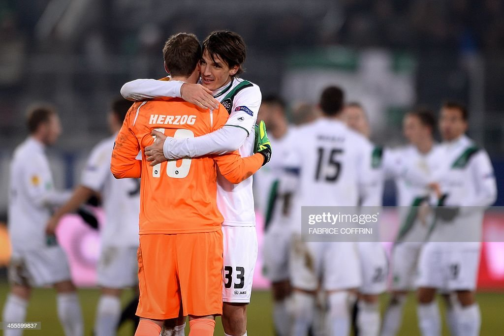 Swansea City's Welsh defender Ben Davies (R) greets his goalkeeper Marcel Herzog at the end of the Europa League Group A football match between FC St Gallen and Swansea City on December 12, 2013 at the AFG Arena in St Gallen. Swansea lost 1-0. AFP PHOTO / FABRICE COFFRINI