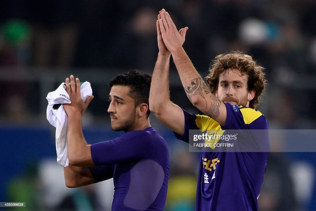 Swansea City's Welsh defender Neil Taylor (L) and Swansea City's Spanish midfielder Jose Alberto Canas applaud at the end of the Europa League Group A football match between FC St Gallen and Swansea City on December 12, 2013 at the AFG Arena in St Gallen. Swansea lost 1-0.