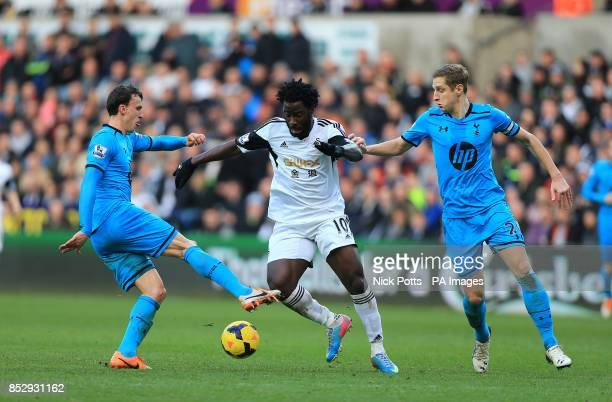 Swansea City's Wilfried Bony battles for the ball with Tottenham Hotspur's Vlad Chiriches and Michael Dawson