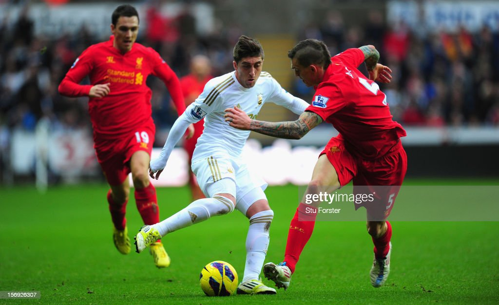 Swansea forward Pablo Hernandez (c) takes on the Liverpool defence during the Barclays Premier League match between Swansea City and Liverpool at Liberty Stadium on November 25, 2012 in Swansea, Wales.