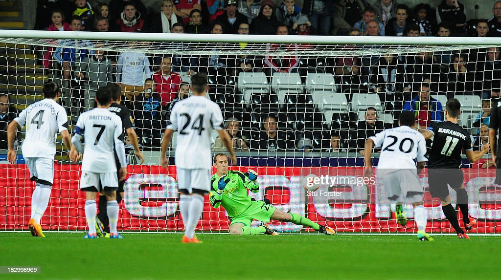 Swansea goalkeeper <a gi-track='captionPersonalityLinkClicked' href=/galleries/search?phrase=Gerhard+Tremmel&family=editorial&specificpeople=751125 ng-click='$event.stopPropagation()'>Gerhard Tremmel</a> saves a penalty from St Gallen player Goran Kranovic during the UEFA Europa League match between Swansea City and FC St Gallen at Liberty Stadium on October 3, 2013 in Swansea, Wales.