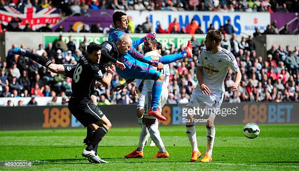 Swansea goalkeeper Lukasz Fabianski is challenged by Steven Naismith and Gareth Barry of Everton during the Barclays Premier League match between...