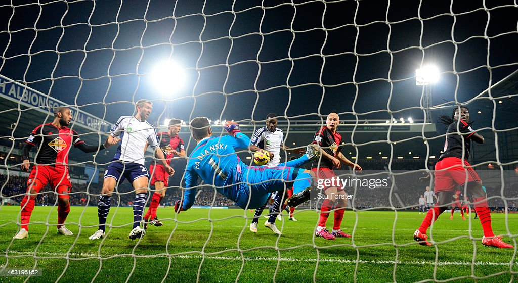 Swansea goalkeeper Lukasz Fabianski makes a goaline save during the Barclays Premier League match between West Bromwich Albion and Swansea City at The Hawthorns on February 11, 2015 in West Bromwich, England.