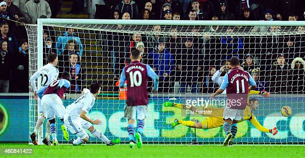 Swansea goalkeeper Lukasz Fabianski makes a last minute save to deny Villa an equaliser during the Barclays Premier League match between Swansea City...