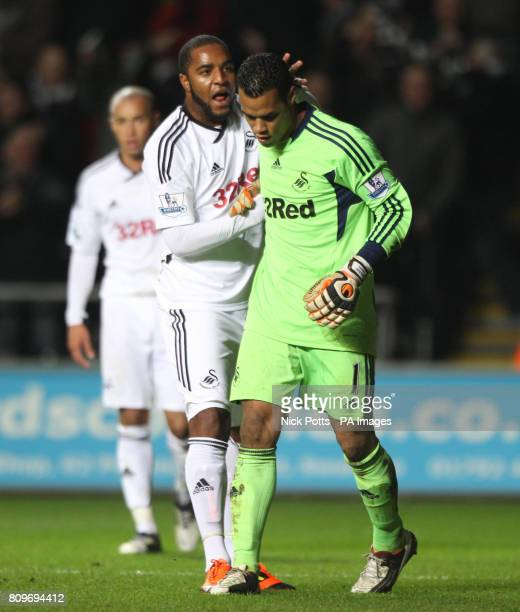 Swansea goalkeeper Michel Vorm celebrates with Kemy Agustien after saving Fulham Clint Dempsey's second half penalty during the Barclays Premier...