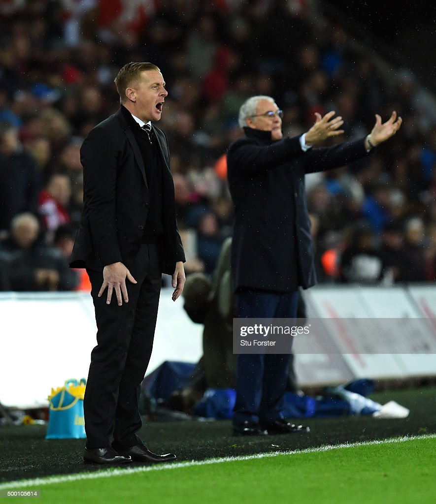 Swansea manager Garry Monk (l) and Claudio Ranieri (r) react during the Barclays Premier League match between Swansea City and Leicester City at Liberty Stadium on December 5, 2015 in Swansea, Wales.