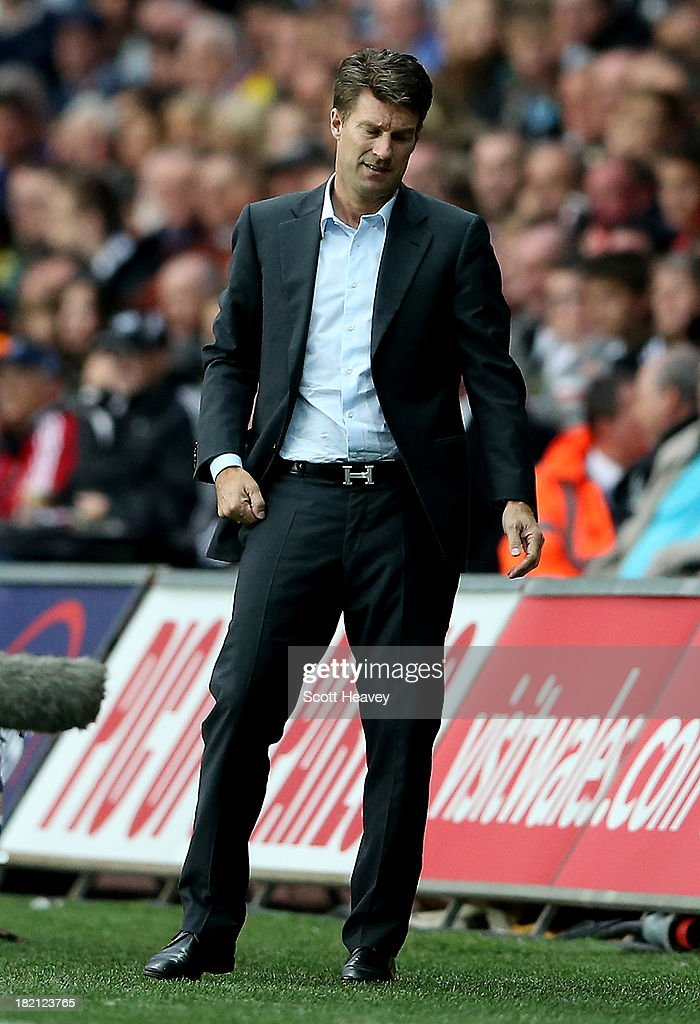 Swansea manager <a gi-track='captionPersonalityLinkClicked' href=/galleries/search?phrase=Michael+Laudrup&family=editorial&specificpeople=2380115 ng-click='$event.stopPropagation()'>Michael Laudrup</a> during the Barclays Premier League match between Swansea City and Arsenal at Liberty Stadium on September 28, 2013 in Swansea, Wales.