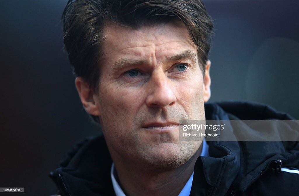 Swansea Manager <a gi-track='captionPersonalityLinkClicked' href=/galleries/search?phrase=Michael+Laudrup&family=editorial&specificpeople=2380115 ng-click='$event.stopPropagation()'>Michael Laudrup</a> during the Barclays Premier League match between Aston Villa and Swansea City at Villa Park on December 28, 2013 in Birmingham, England.