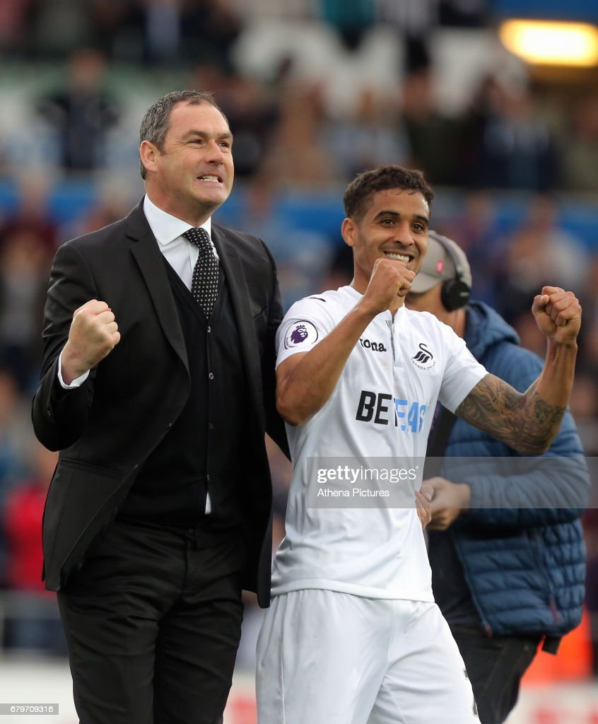 Swansea manager Paul Clement and Kyle Naughton of Swansea City celebrate their team's win after the Premier League match between Swansea City and Everton at The Liberty Stadium on May 6, 2017 in Swansea, Wales.