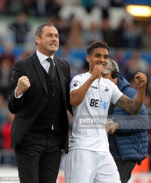 Swansea manager Paul Clement and Kyle Naughton of Swansea City celebrate their team's win after the Premier League match between Swansea City and...