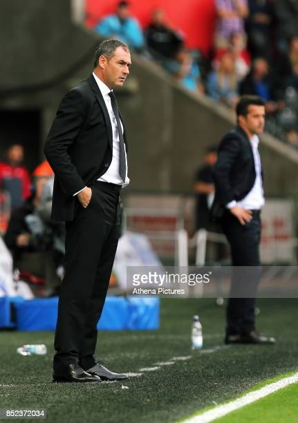 Swansea manager Paul Clement and Watford manager Marco Silva stand on their touch lines during the Premier League match between Swansea City and...