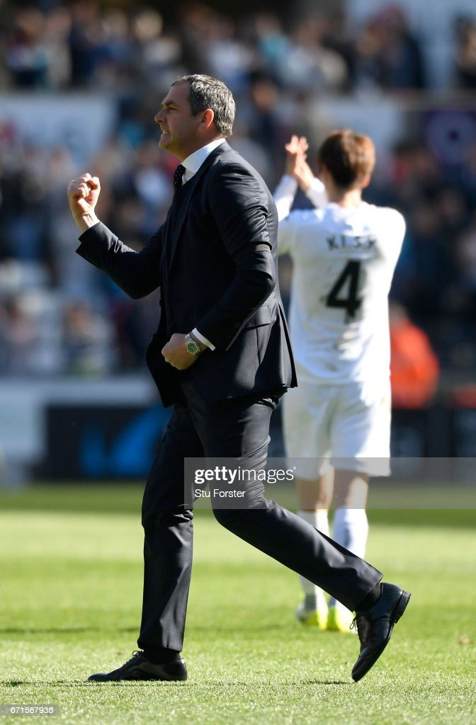 Swansea manager Paul Clement celebrates after the Premier League match between Swansea City and Stoke City at Liberty Stadium on April 22, 2017 in Swansea, Wales.