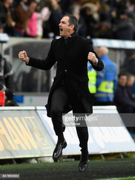 Swansea manager Paul Clement celebrates the winning goal by running down the touchline during the Premier League match between Swansea City and...