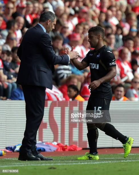 Swansea manager Paul Clement greets Wayne Routledge of Swansea City as he comes off the pitch during the Premier League match between Southampton and...