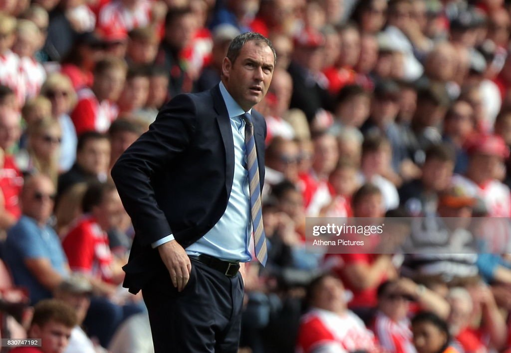 Swansea manager Paul Clement looks towards his away fans during the Premier League match between Southampton and Swansea City at the St Mary's Stadium on August 12, 2017 in Southampton, England.