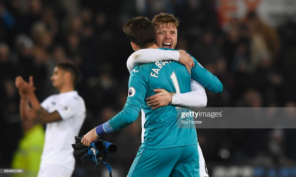 Swansea player Alfie Mawson celebrates with goalkeeper Lukasz Fabianski after the Premier League match between Swansea City and Leicester City at Liberty Stadium on February 12, 2017 in Swansea, Wales.