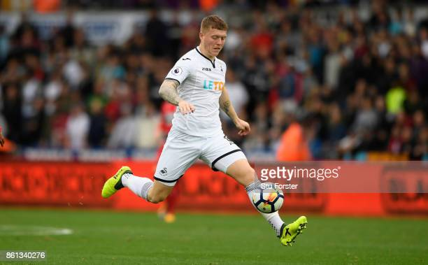 Swansea player Alfie Mawson in action during the Premier League match between Swansea City and Huddersfield Town at Liberty Stadium on October 14...
