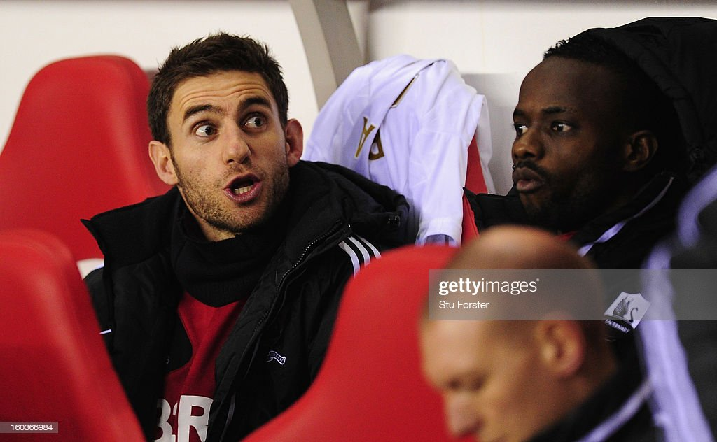 Swansea player Angel Rangel (l) looks on before the Barclays Premier League match between Sunderland and Swansea City at Stadium of Light on January 29, 2013 in Sunderland, England.