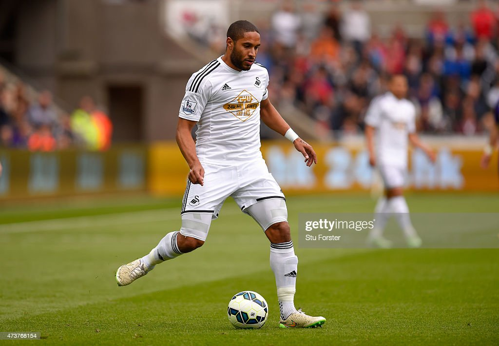 Swansea player <a gi-track='captionPersonalityLinkClicked' href=/galleries/search?phrase=Ashley+Williams+-+Soccer+Player&family=editorial&specificpeople=13495389 ng-click='$event.stopPropagation()'>Ashley Williams</a> in action during the Barclays Premier League match between Swansea City and Manchester City at Liberty Stadium on May 17, 2015 in Swansea, Wales.